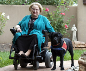 Marcie Davis posing with her dog, Lovey.